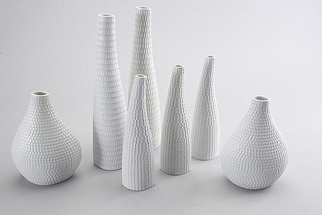 Stig lindberg, a set of seven reptil stone ware vases.
