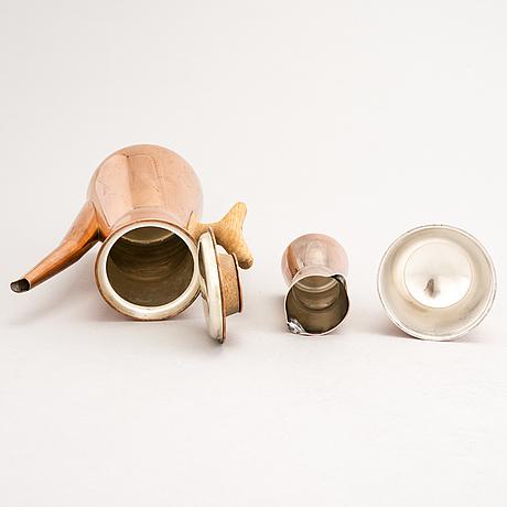 A 4-piece copper coffee set, three of four designed by tapio wirkkala.