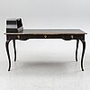 An early 20th century rococo style writing desk.