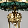 An early 20th century empire style table lamp.
