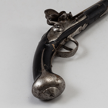 One flint lock postol, late 18th ct, and one percussion pistol, 19th ct.