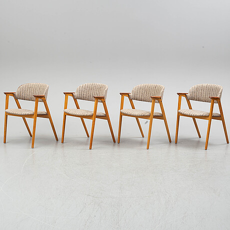 Four mid 20th century armchairs.