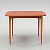 A second half of the 20th century teak veneered dining table.
