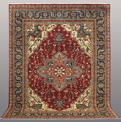 A carpet, feraghan design, 311 x 245 cm.