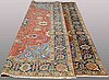 A carpet, semi-antique tabriz, 355 x 255 cm.