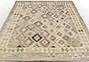 A kilim rug, ca 256 x 207 cm.