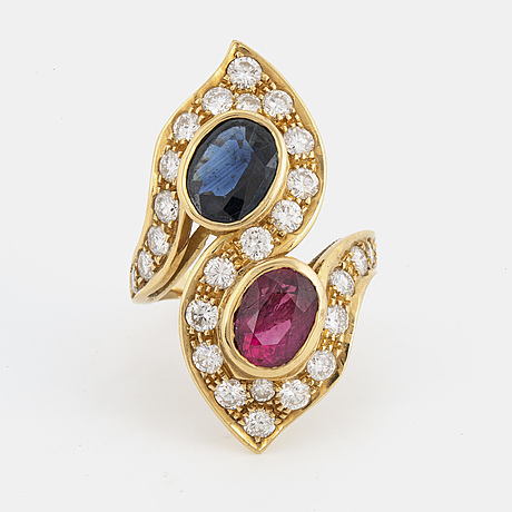 Ruby and sapphire  cross over ring, with brilliant-cut diamonds.