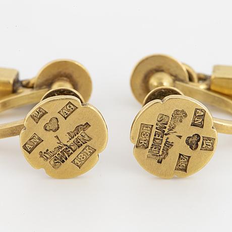 A pair of wiwen nilsson 18k gold earrings.