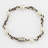 18k white gold and cultured pearl bracelet.