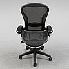 A 'aeron' office chair by herman miller.