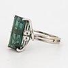 Green tourmalien and brilliant-cut diamond.