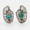 A pair of 18k white gold earrings set with faceted emeralds and old- and eight-cut diamonds.