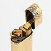 Cartier lighter ,with case 18k gold, elon arenhill.