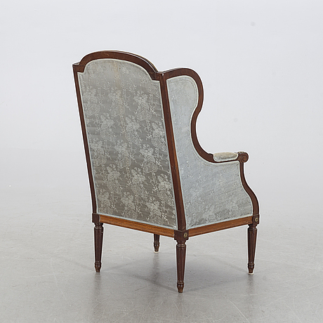 An louis xvi-style arm chair, first half of the 20th century.