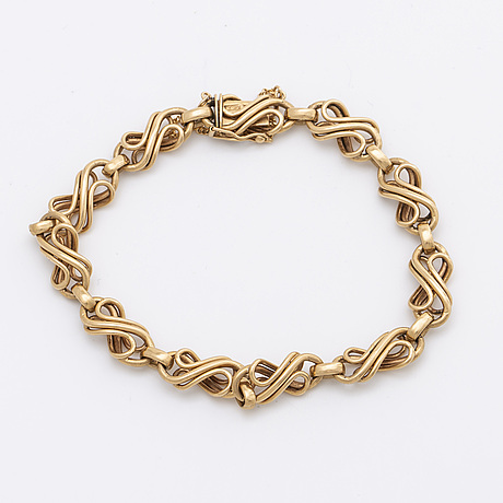 Bracelet and earrings 18k gold, hugo grun & co stockholm 1947.