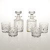A english box with two decanters and four glasses.