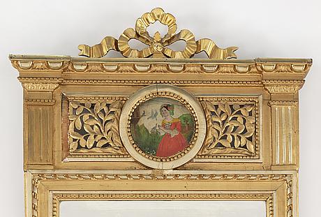 A 19th century gustavian style mirror.