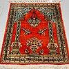 A rug, old silk qum, ca 76 x 54 cm.
