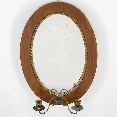 An empire mirror sconce by gustaf holm (master in stockholm from 1834). dated 1839.