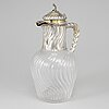 A french rococo style wine jug, glass and silver, paris, second half of the 19th century.