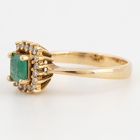 Emerald and brilliant-cut diamond ring.