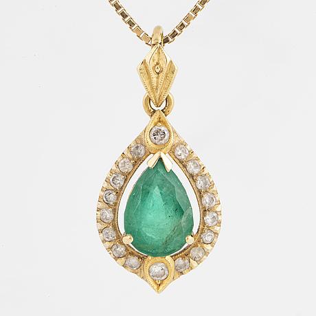 Drop shaped emerald and brilliant-cut diamond.