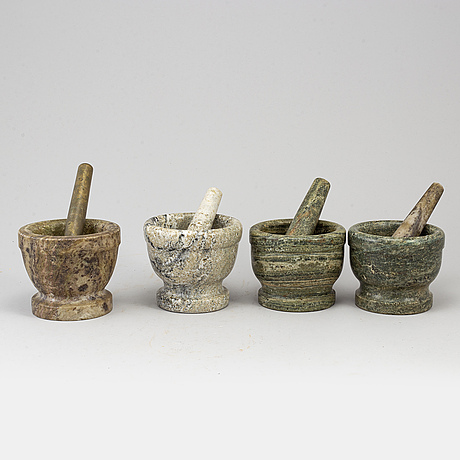 Four swedish green marble mortars and pestles, early 19th century.