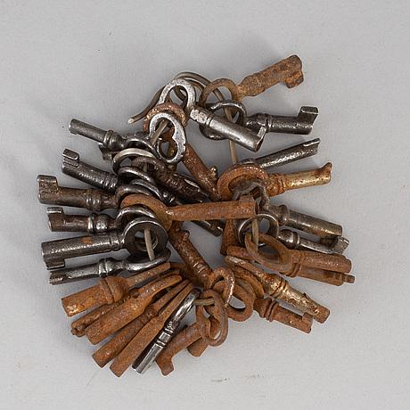35 miniature iron keys,  19th/20th century.
