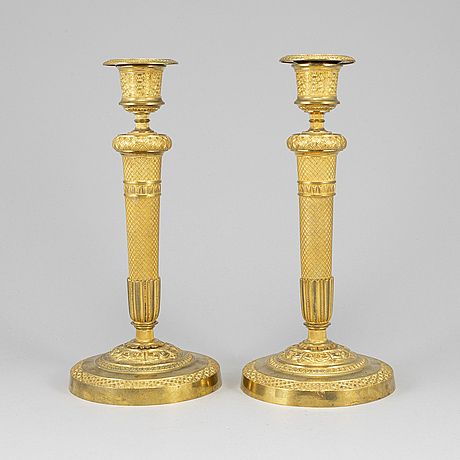 A pair of ormolu candlesticks, first half of the 19th century.