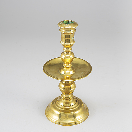 A bronze candlestick, 16th/17th century.