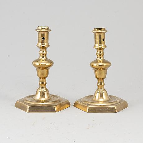 A pair of 17th century bronze candlesticks.