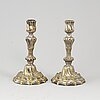 A pair of 18th century argent haché candlesticks.