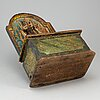 A painted wood alms box, probably 17th century.