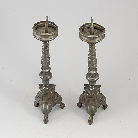 A pair of 17th century pewter candlesticks.