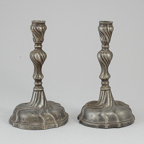 A pair of 18th century pewter candlesticks.