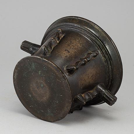 A 16th century bronze mortar.