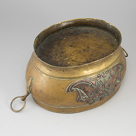 A 17th century brass and copper champagne cooler.