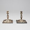 A pair of 19th century silver candlesticks.