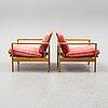 Erik wØrts, a pair of oak 'kastrup' easy chairs from ikea, designed in 1961.