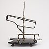 Mechanical wine decanting cradle, europe, early 20th century.