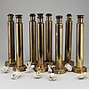 Eight second half of the 20th century brass table lights by ea, kosta.