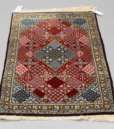 A rug, old qum, part silk, ca 113 x 70 cm.