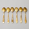 A 19-piece set of enamelled and gilt silver spoons and two serving forks, tillander, helsinki 1950s.
