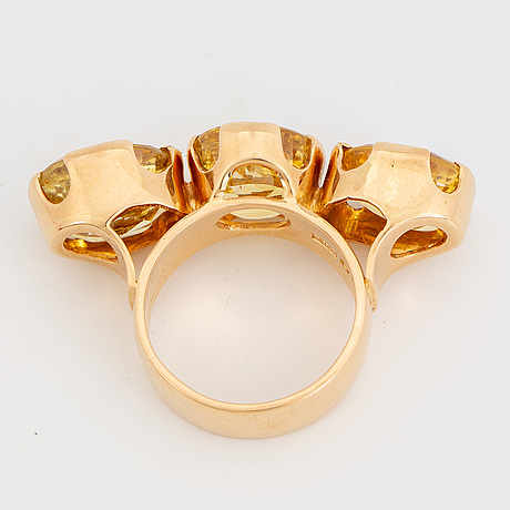 18k gold and yellow sapphire three-stone ring.