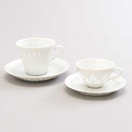 Friedl holzer-kjellberg, a set of 11 porcelain coffee cups in two sizes, signed f.h.kj. arabia finland.
