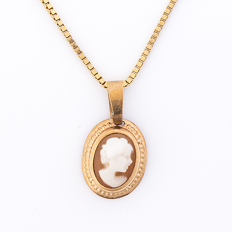 A set of two cameo and 14k gold pendant and a necklace.