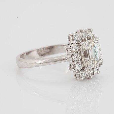 An 18k gold ring set with an emerald-cut diamond 2.04 cts quality j vs1.