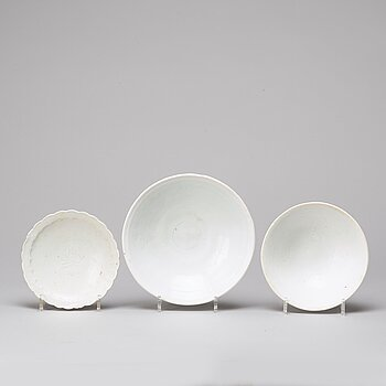 A group of three white glazed dishes, South East Asia, presumably 13th/15th Century.