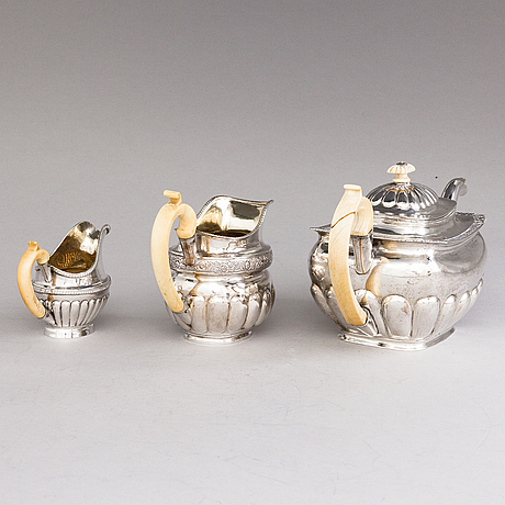 A russian silver teapot and two silver milk jugs, st petersburg 1824-1839, jugs marked georg randelin and thomas sohka.