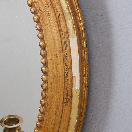 A pair of 20th century, gustavian style mirror sconces.